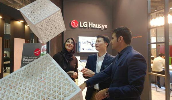 LG Hausys exhibitor is showing around products at housing material exhibition held in Iran on February 6-9.