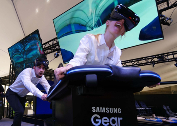 Models experience Samsung Electronics' Gear VR at the company's booth for the Mobile World Congress 2017 in Barcelona on Sunday.