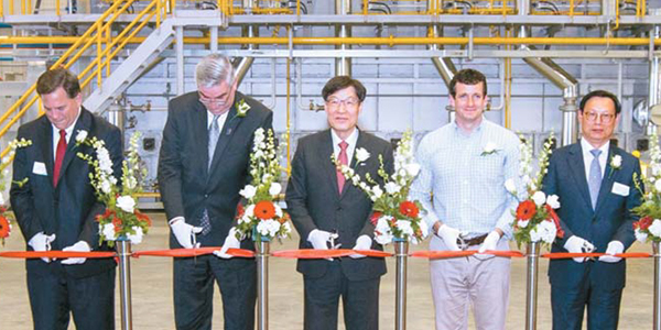 The ribbon-cutting at the new Posco Indiana Wire Rod Processing Center grand opening ceremony gets underway on Friday with (from second left) Indiana Gov. Eric Holcomb, Posco CEO Kwon Oh-joon, U.S. Congressman Trey Hollingsworth and South Korean Consul General Lee Jong-Kook. [Photo by Posco]