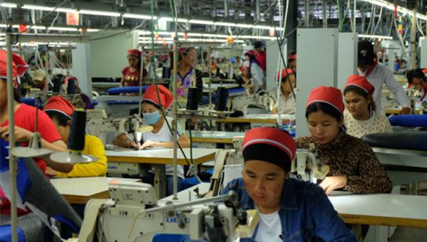 Workers stitch clothes at a garment factory in Sihanoukville`s Special Economic Zone.