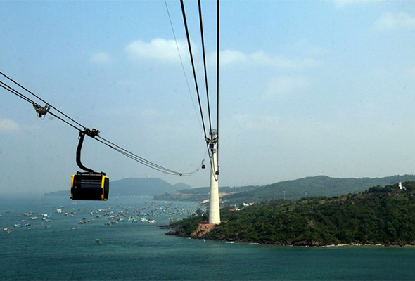 A cabin travels on the world's longest sea cable car which was inaugurated in Phú Quốc Island District in the southern province of Kiên Giang yesterday.