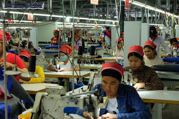 Workers stitch clothes at a garment factory in the Sihanoukville Special Economic Zone.