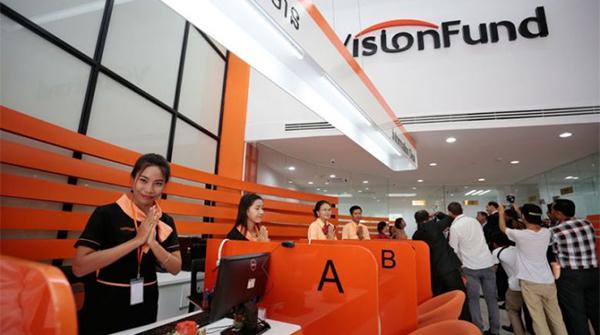 Employee at VisionFund greets customers. [Hong Menea]