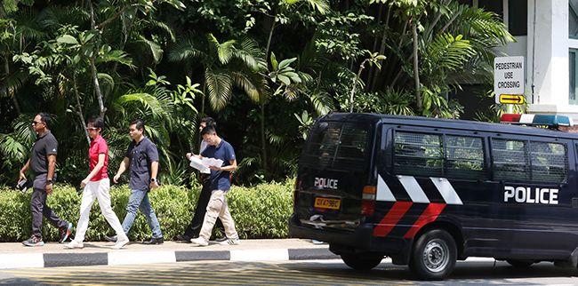 7일 6.12 북미정상회담이 열리는 싱가포르 카펠라 호텔에서 사복 경찰들이 진입로 등을 살피고 있다. /사진=연합뉴스
