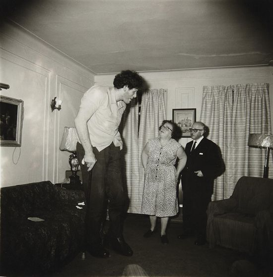 A Jewish giant at home with his parents in the Bronx, N.Y. 1970
