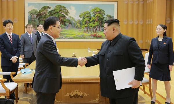 (From right) North Korean leader Kim Jong-un shaking hands with Chung Eui-yong.