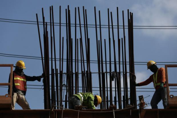 Workers at a construction site for the North Green Line train route.&#8201;PATIPAT JANTHONG <br><br>