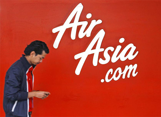 Shares in AirAsia Group fall as much as 10 percent on May 14 in the first trading session since Mr Fernandes' public apology. [Photo EPA]