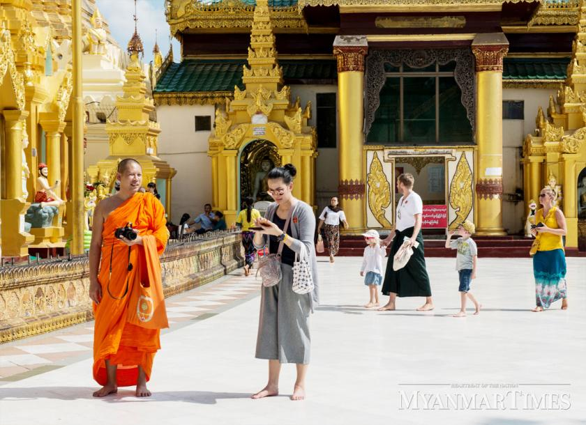 Tourists visit the Shwedagon Pagoda in Yangon earlier this year. [Aung Htay Hlaing/The Myanmar Times]