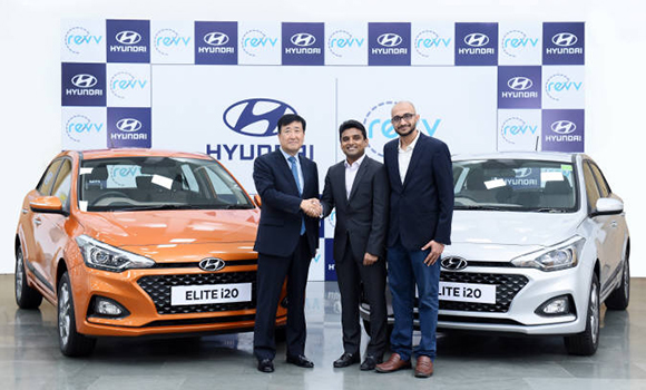 Hyundai Motor India CEO Koo Young-key (Left) shakes hands with Revv co-founder Anupam Agarwal (Center), with another Revv co-founder, Karan Jain. [Photo provided by Hyundai Motor Co.]