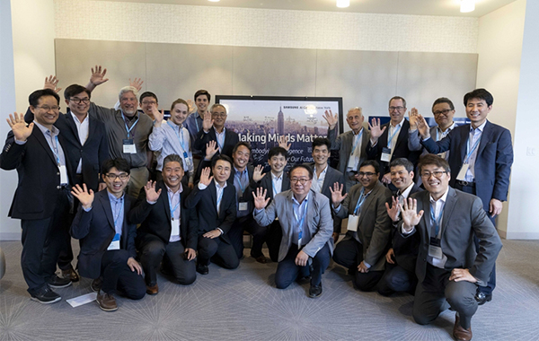 Participants at the AI research center in New York City ceremony are taking commemorative photo. [Photo provided by Samsung Electronics Co. ]