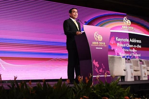 Prime Minister Prayut Chan-o-cha delivers his speech to the Asean Business and Investment Summit on the sidelines of the 33rd Asean Summit and Related Meetings in Singapore on Tuesday. (AFP photo)