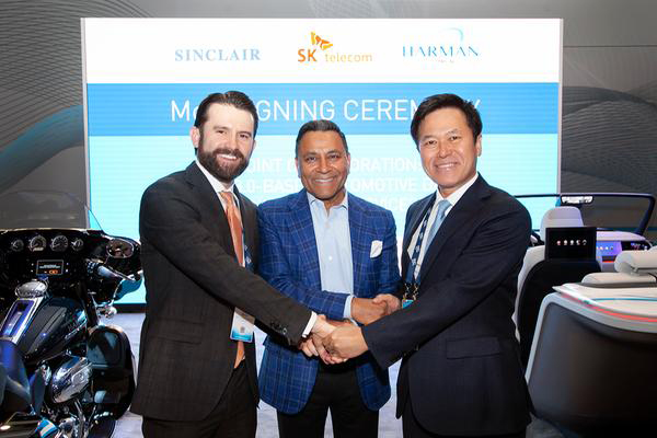 (From left) Sinclair Broadcast Group's CEO Christopher S.Ripley, SK Telecom's chief executive officer Park Jung-ho, and Harman's President and CEO Dinesh Paliwal. [Photo provided by SK Telecom]