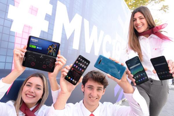 LG Electronics models are introducing a new lineup of smartphones including the LG V50 ThinQ, LG G8 ThinQ, LG Q60, LG K50 and LG K40 (from left) at the entrance of Barcelona`s Fira Gran Via during the World Mobile Congress.