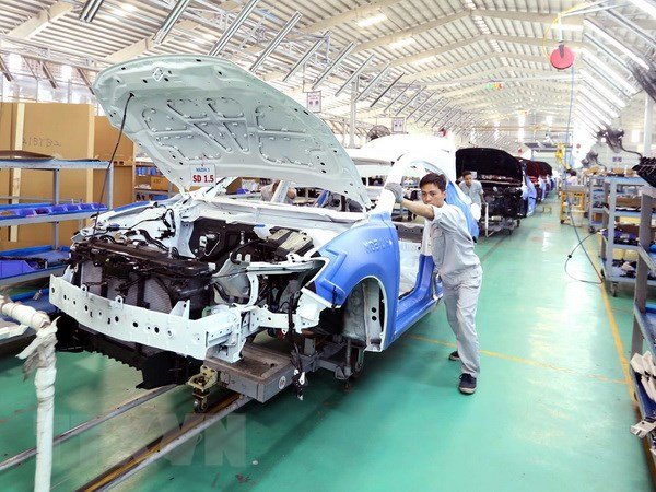 An automobile manufacturing line of the Truong Hai Automobile Joint-Stock Company at the Chu Lai-Truong Hai Industrial Complex in the central province of Quang Nam. - VNA/VNS Photo Vu Sinh