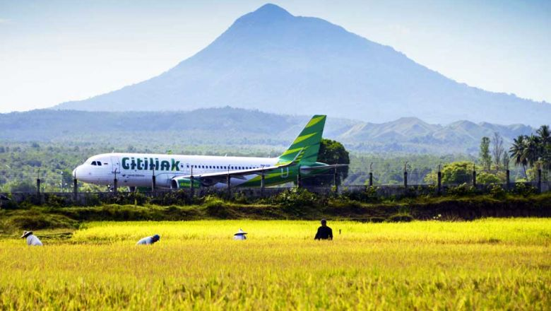 A Citilink airplane takes off from a runway beside a paddy field at Blang Bintang airport in Banda Aceh, Indonesia. CHAIDEER MAHYUDDIN/AFP