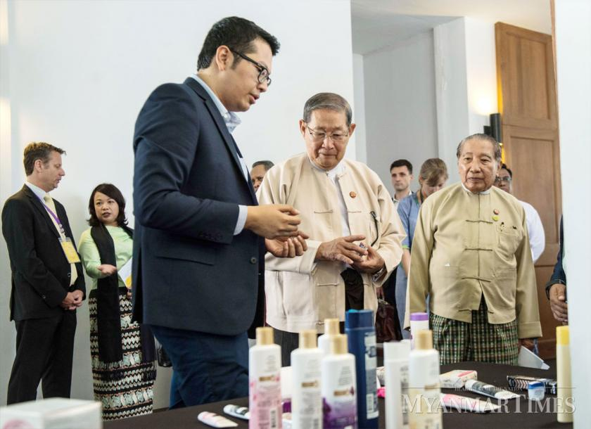 Minister of Planning and Finance U Soe Win inspects samples of illicit goods at the Anti-Illicit Trade Forum held in Nay Pyi Taw. Aung Htay Hlaing/The Myanmar Times