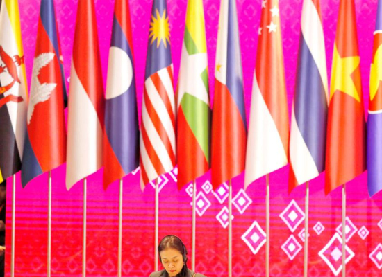 ASEAN country flags behind a staff member making preparations during the 35th Association of Southeast Asian Nations (ASEAN) Summit and Related Summits in Nonthaburi province, Thailand, earlier this month. Photo - EPA