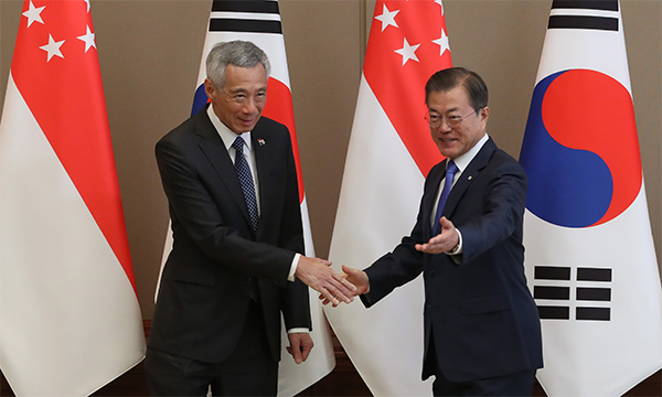 South Korean President Moon Jae-in (right) shakes hands with Singapore