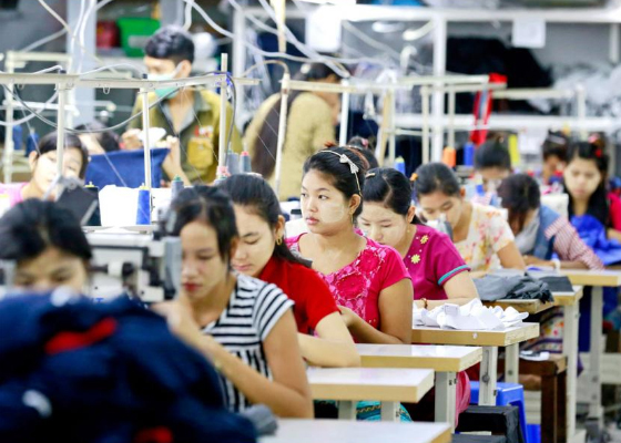 Employees work at a garment factory in Shwe Pyi Thar, Yangon. A new EU project seeks to boost social and environmental sustainability in Myanmar's garment industry. Photo: EPA