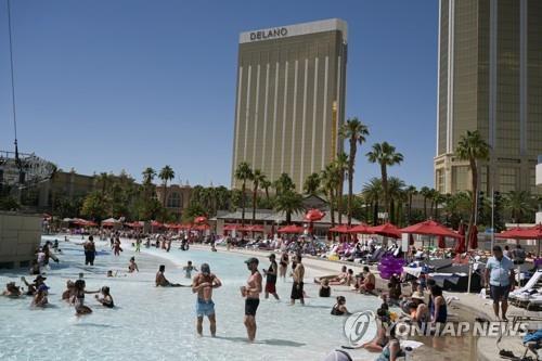 Tourists enjoying a dip in a Las Vegas hotel pool